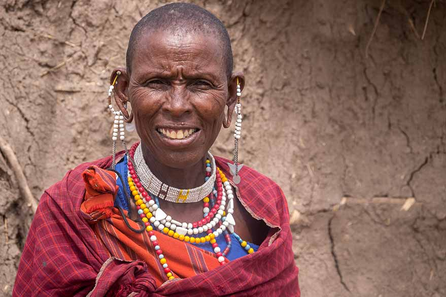 Maasai woman, on your trip to Kenya on an all-terrain motorcycle with Fred and Planet Ride
