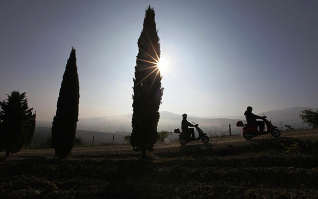 Travel in Italy with moped scooter vespa with a local travel agency