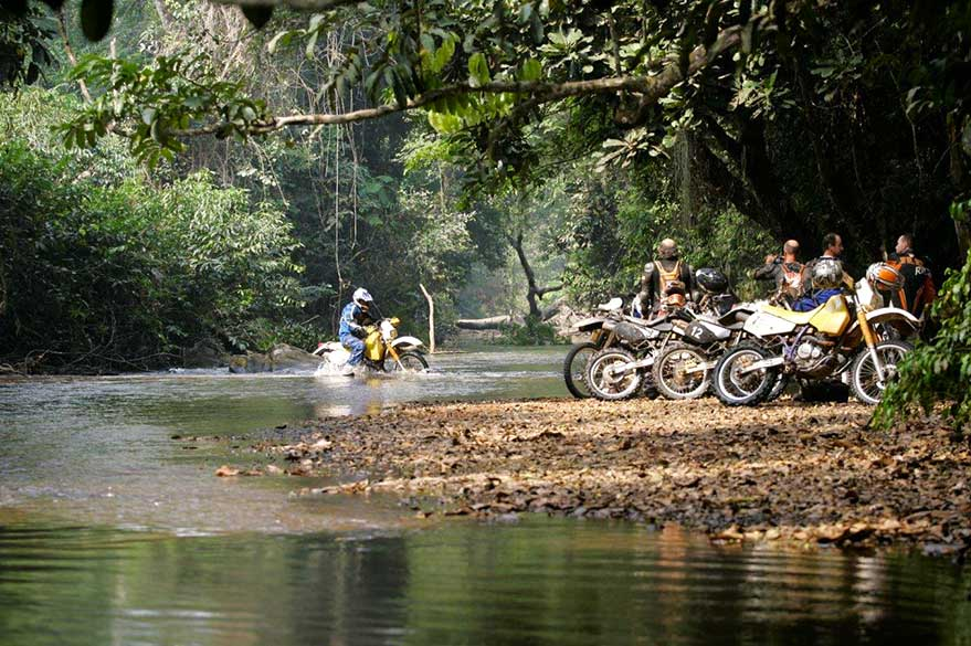 Crossing the river in Togo, during a motorcycle raid in Burkina Faso and Togo with Guillaume and Planet Ride