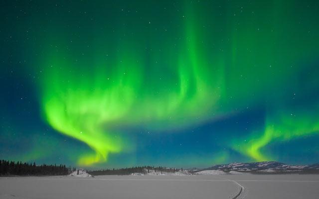 Aurores boréales de Norvège lros de votre voyage avec Planet Ride
