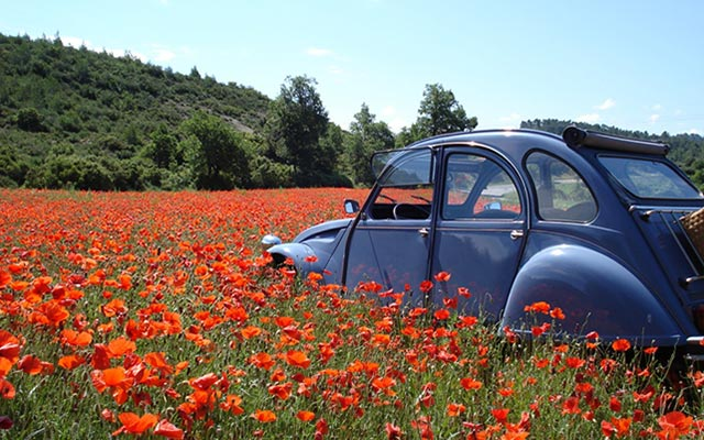 Travel in France with legendary vehicle with a local travel agency