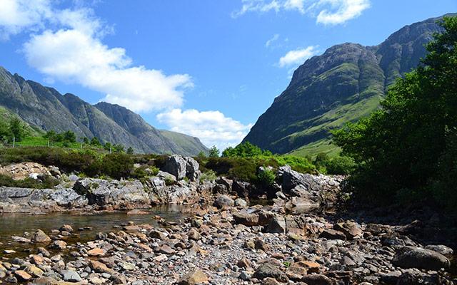 planet ride voyage moto ecosse ruisseau paysage montagnes
